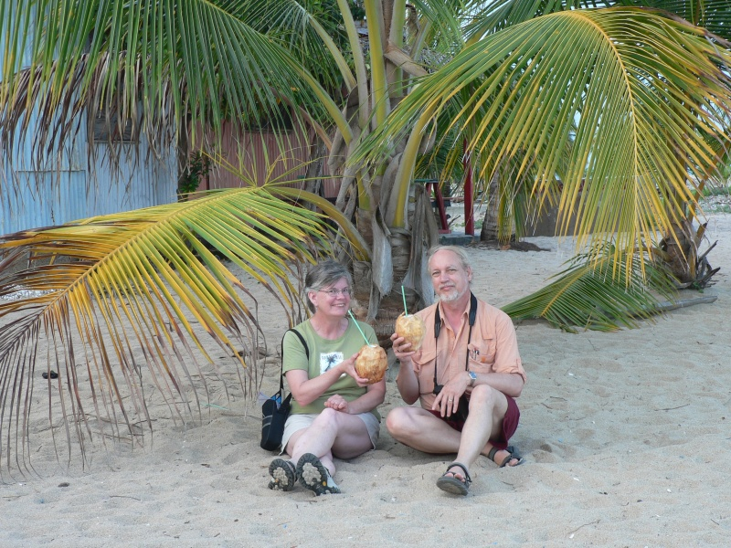 Tom and Deb drinking coconut juice in Placencia
